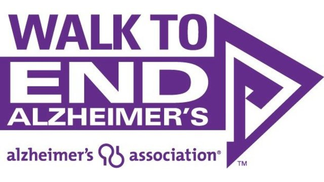 Hundreds of people are marching in a walk to end Alzheimer's
